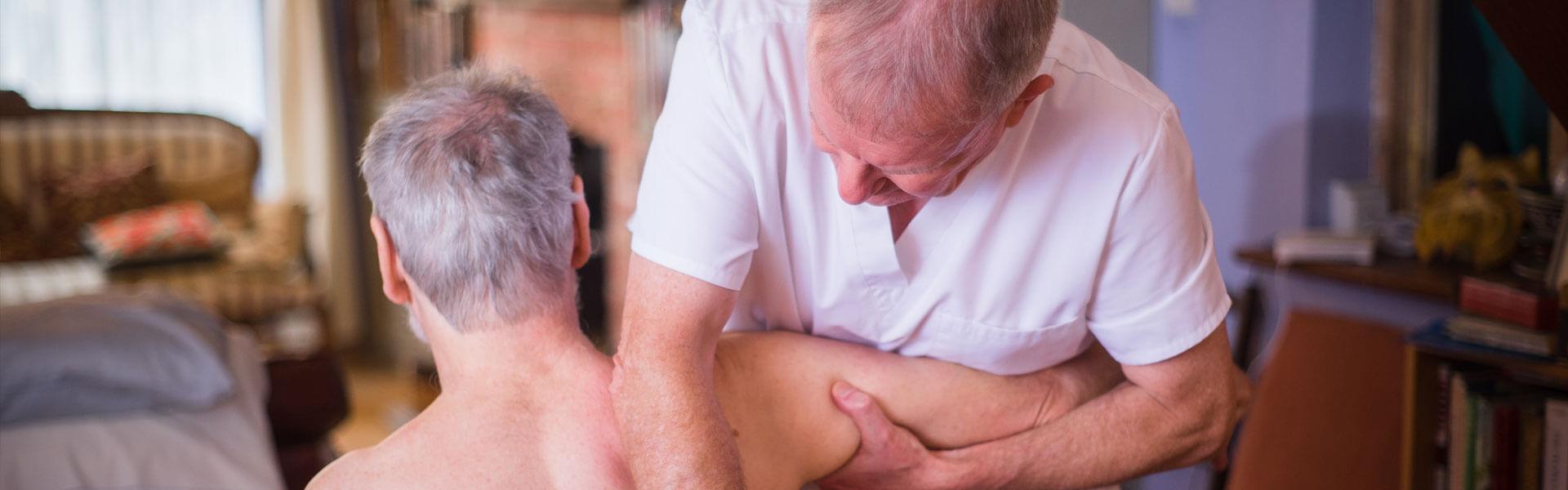 Slider image showing curative massage to back