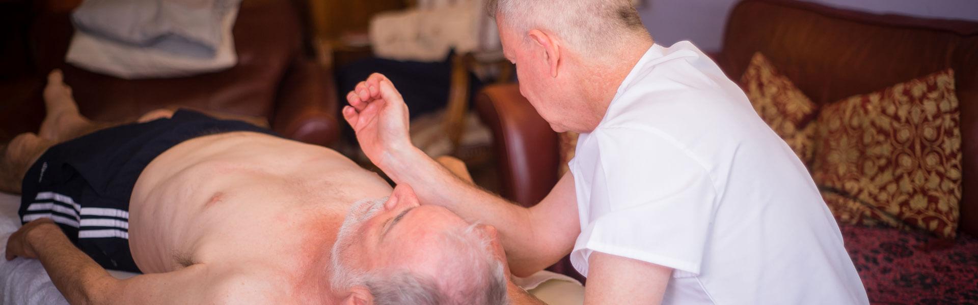 Slider image showing forearm curative massage to shoulder